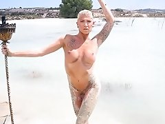 Seductive Danni posing in mud