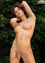 Red haired tgirl superstar Domino Presley is sitting poolside in her bikini. She has a beautiful big tits, nice thick ass and a juicy tgirl cock.