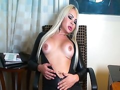 Very Hot Blonde TransGirl in leather stroking while doing phone sex